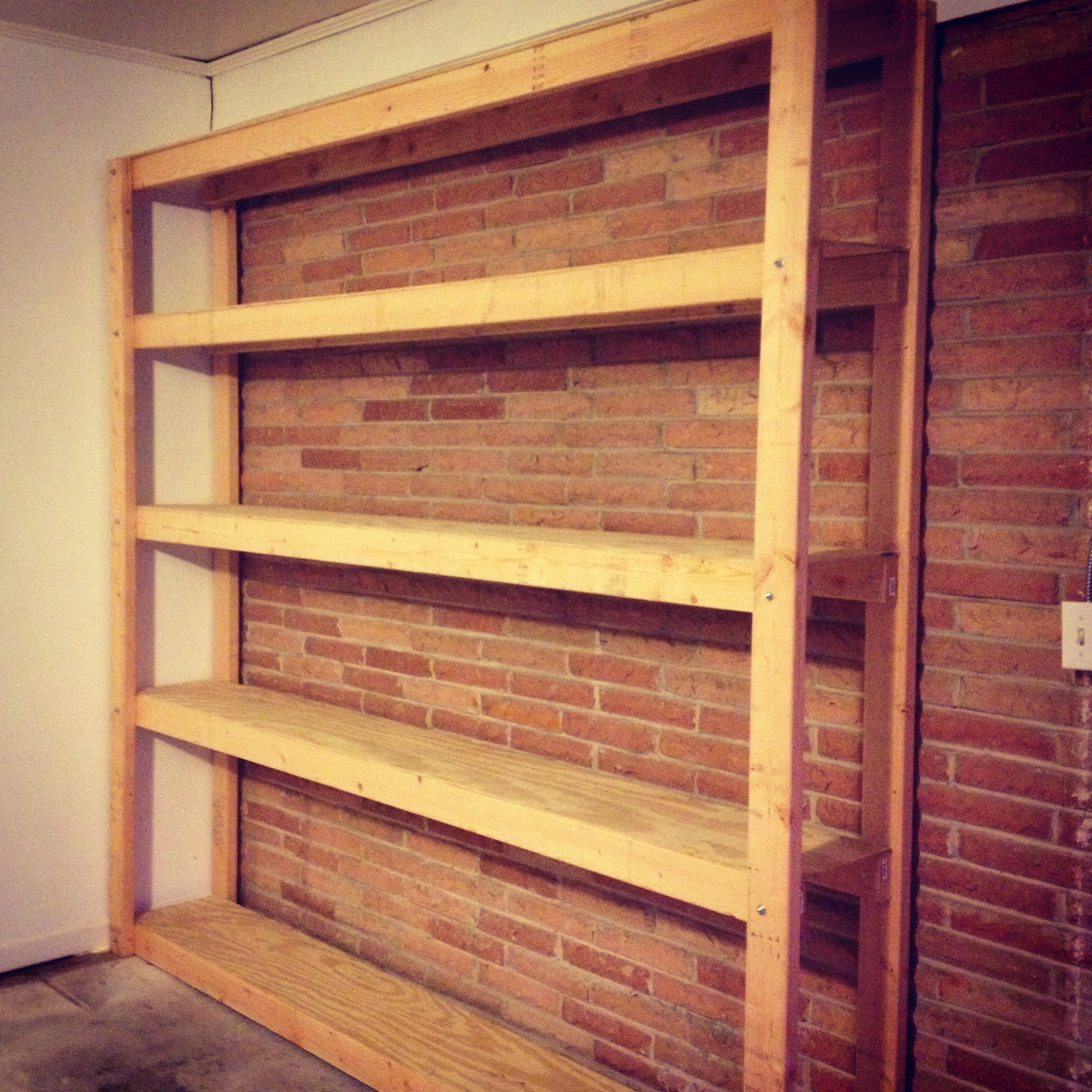 How to build shelves for your garage parties for pennies for Diy garage plans