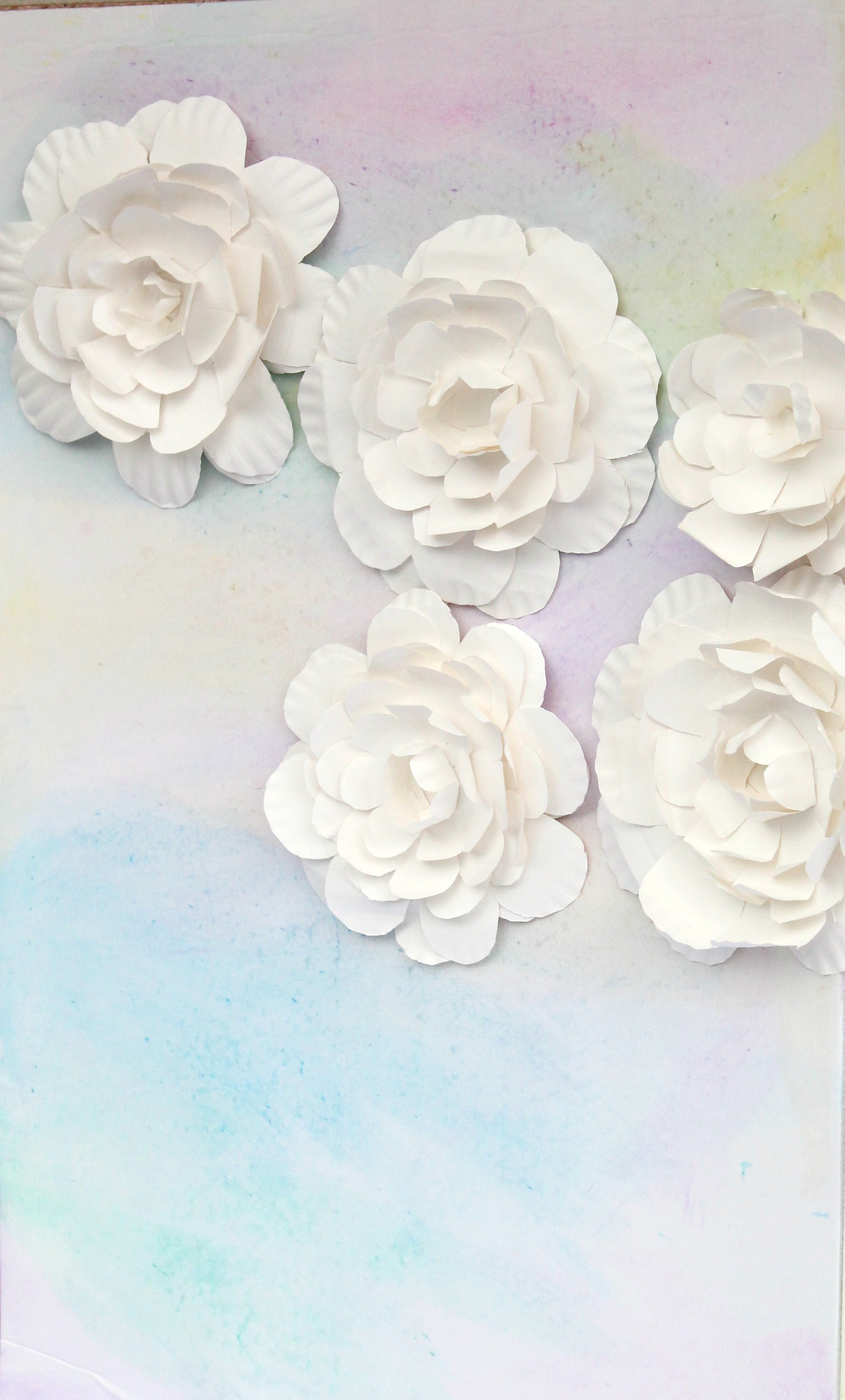 Watercolor Baby Shower Backdrop with Paper Plate Flowers by PartiesforPennies.com