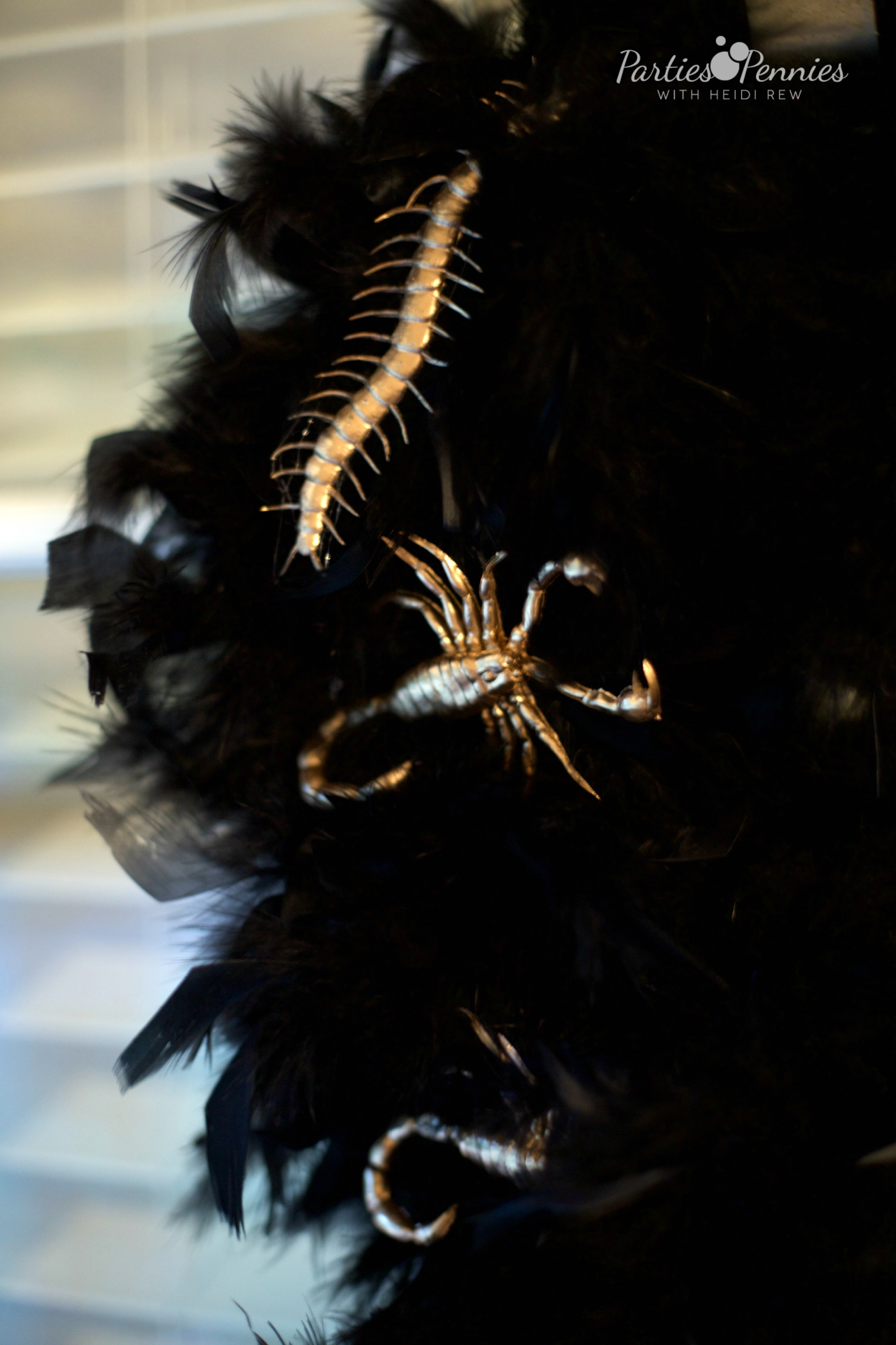 Beetlejuice Halloween Party | PartiesforPennies.com | Feather and Bug Wreath