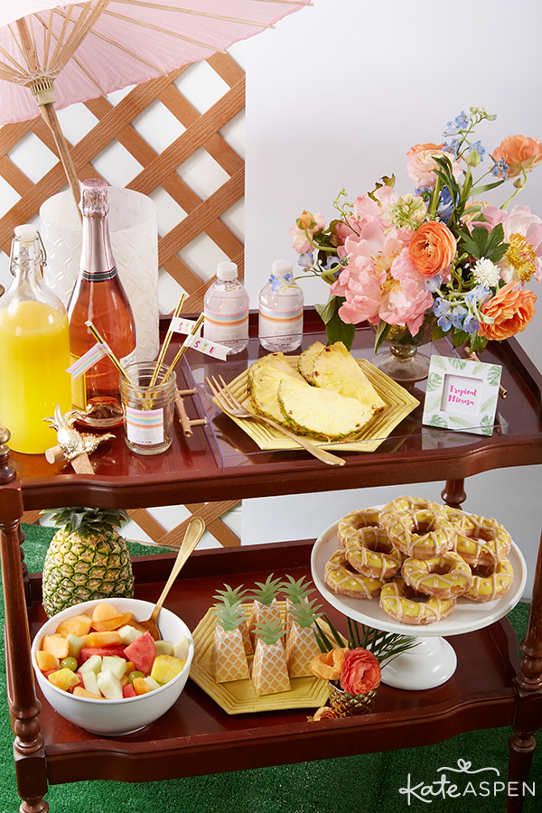 Everything you need to throw a Palm Spring Inspired Bridal Shower! Check out this Pineapple and Palms Bridal Shower with Kate Aspen on PartiesforPennies.com | Bar Cart