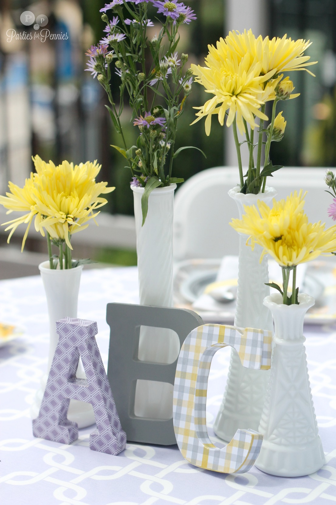 50 Ideas for Planning a Baby Shower | PartiesforPennies.com | Purple, Gray, and Yellow Baby Shower