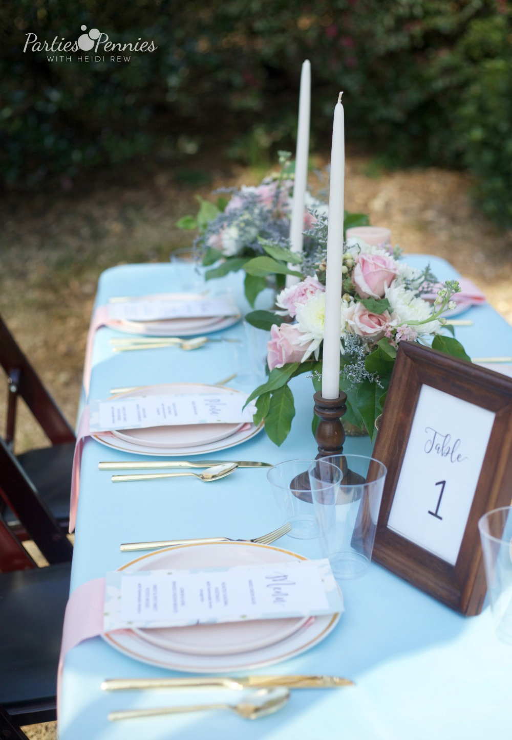 How to Plan a Wedding for under $5,000 | PartiesforPennies.com | Reception Table, Blue Tablecloth, Blue, Pink, Floral Arrangement