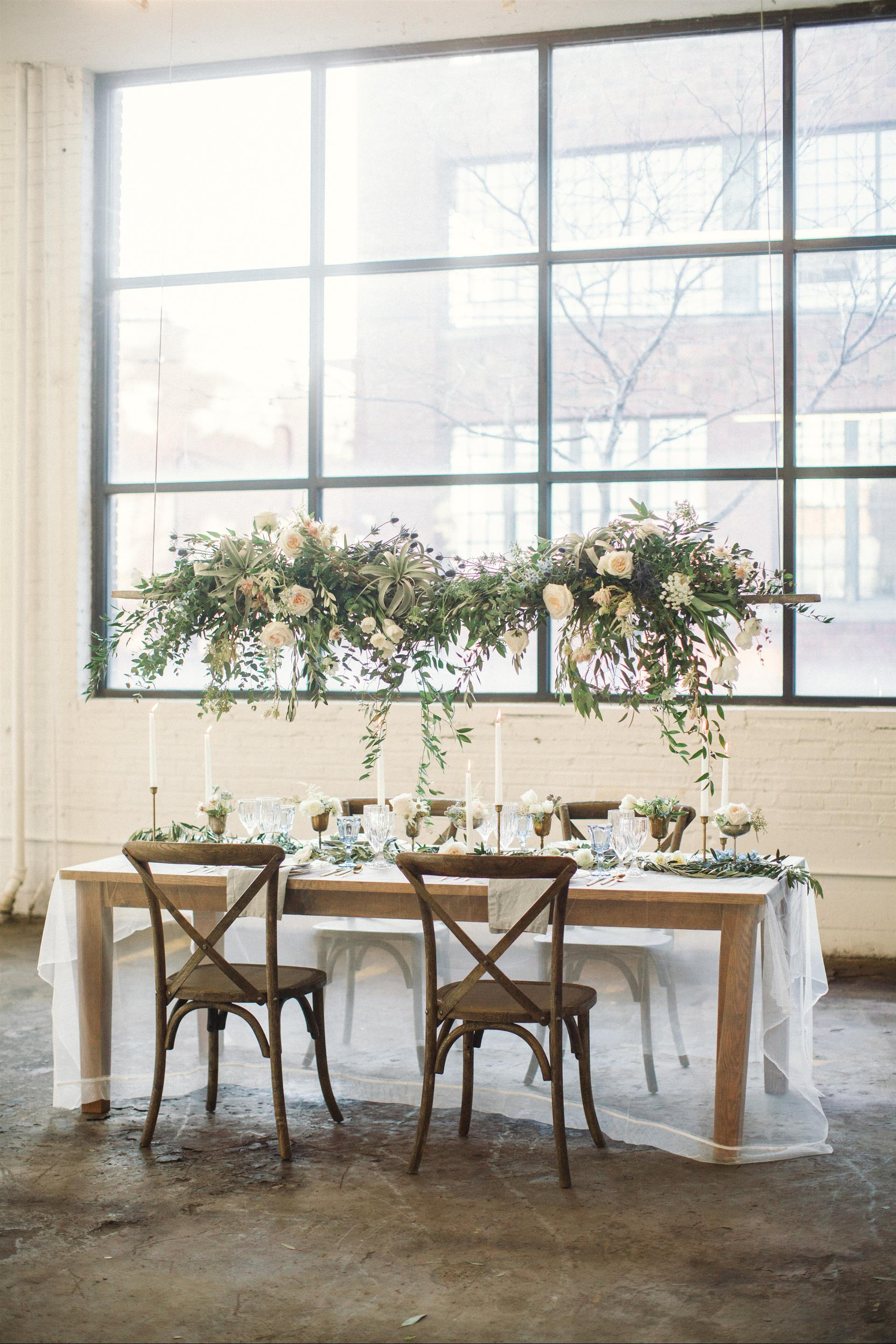 Feminine Wedding Inspiration by A Charming Fete | PartiesforPennies.com | Hanging Centerpiece, Greenery, Reception Table, Wedding